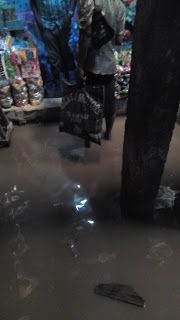 See How Water Flooded into People's Shop at Ariaria Market Today After Heavy Rainfall (Photos)   There was a heavy rain at Aba today that water flooded every corners of the shop. Its not something one can wright home about. Aba is not always the best when it comes to good road especially when it rains. So I took some pictures to share with you guys!. You can imagine the type of flood it is that made me pick up my phone to grab some shots. Below are more of the pictures...