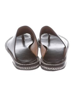 289dc7b6ef02 Black leather Givenchy slide sandals with silver-tone chain-link trim  throughout soles.