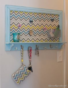 See how a fresh coat of chalk paint and aqua and yellow chevron fabric gave new life to this old memo board/key holder. You'd never guess it originally came from someone's trash!