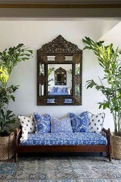 An Indian Summer, a large ornate mirror to reflect the mirror across from it, blue and white daybed.