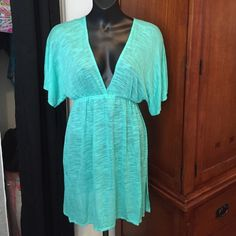 Vitamin A brand cover up/dress. NWT size L I am so sad to put this up for sale. I bought it from a posher who described it as one size. It is clearly a large and says on the tag. So someone will be very happy to receive a brand new yummy Vitamin A piece. Vitamin A is the latest chicest beachwear line. In boutiques throughout Cali and at resorts around the world. I have three of their maxi dresses I LOVE because of the fabric softness and cut and style.color is Aqua so I chose green and blue…