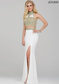 Gorgeous two-piece dress features a beaded embellished top and jersey skirt with sexy slit available at Hope's Bridal