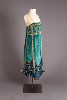 The beaded flapper dress is well established as the clothing of the 1920's and was worn by ,pst woman on nights out. These were embellished with beads, pearls and dimonties