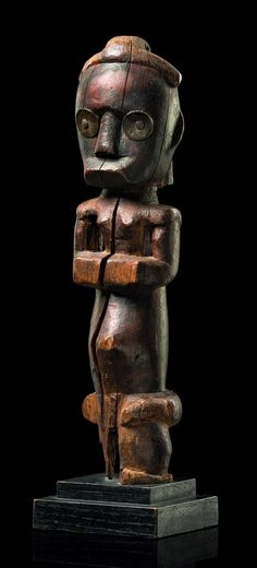 Africa | Guardian figure of a reliquary ensemble from the Ntumu, Fang people of Gabon | Wood, brass discs