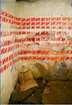 """Imagine an inmate sitting in his cell with little else to keep him company but a red marker as he marks off each day that passes. The island is totally abandoned now: only shepherds live here in place of those who once resided within the prison walls. An estimated 4,000 were killed by other inmates or guards, or were otherwise executed."" - Written by: Michele Collet"