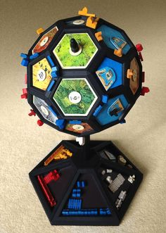 Picture of Globefarers of Catan - check out this amazing mod for Settlers of Catan!  http://www.instructables.com/id/Globefarers-of-Catan/