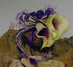 Prom on the Rocks- Calla Lilies  If you are looking for an elegant corsage try   miniature Calla lilies.  They come in many different colors- yellow, rusty reds, many shades of pink,   dark purple-y eggplant and of course classic white.