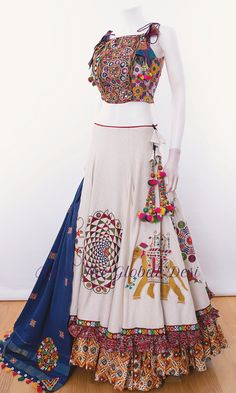 Fabric : cotton Work : embroidery occation : navratri,party Look tempting in this white designer chaniya choli set ,full flare meters) layered chaniya featuring all over embroidery on upper layer.peplum style choli featuring two ch Party Wear Indian Dresses, Indian Fashion Dresses, Designer Party Wear Dresses, Indian Gowns Dresses, Indian Bridal Outfits, Kurti Designs Party Wear, Dress Indian Style, Indian Designer Outfits, Party Wear Lehenga