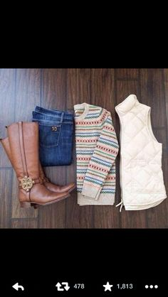 sweater layered under a vest