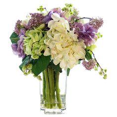Faux hydrangea and lavender arrangement in glass vase.   Product: Faux floral arrangementConstruction Material: Silk...