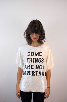 Sequin graphic t-shirt: Some things are not important.