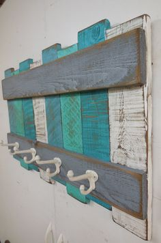 Hello and thank you for stopping by. Here is a very rustic Nautical Coat Rack. Painted beach colors, this coat rack will add a beach theme to any coastal décor. Function meets beauty. Great for outdoors to hang your beach gear or towels. Perfect for your mudroom. Made with aged wood,