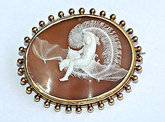 Victorian Shell Cameo, set in gold depicting Shakespeare's Ariel riding a bat