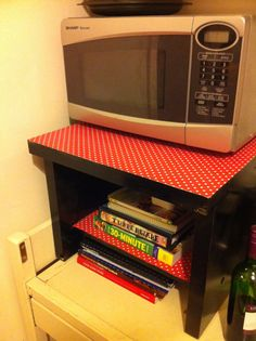 Revamped hard rubbish side table makes a nice microwave stand/ cookbook storage