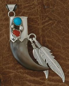Pendant-  - Bear Claw- Turquoise And Red Coral- On Sterling Silver- Navajo Made-   Review the Tribal Impressions Bear Claw Jewelry Collection off of: http://www.indianvillagemall.com/jewelry/bearclaw.html