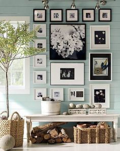 Love the color scheme of the walls and the wood contrast. Picture arrangement and wicker arrangement is beautiful