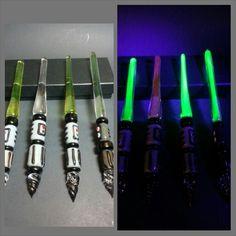 Uv reactive glass lightsaber pens by Cascadia Glassworks