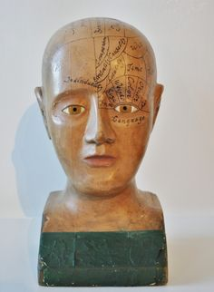 A VERY FINE EXAMPLE CARVED FROM WOOD,POSSIBLY MAPLE, AND PAINTED IN OLD FLESH COLOR WITH GREEN ON BASE. C.1880.