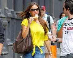 "Even while munching on an ice cream cone, ""Modern Family"" star Sofia Vergara looks stunning."