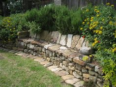 Bench in wall - photographed by Heather Moll-Dunn Landscape and Garden Designer on the Gardens for Connoiseurs Tour around Atlanta. Lovely!