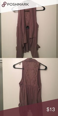 Tank top jacket Adorable shirt that goes over a tank top or tee shirt for an extra look. Has a lace back and pockets on the sides. Great closet staple to give your look an extra something Tops