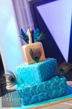 Peacook blue wedding cake, gold and teal with peacock feathers