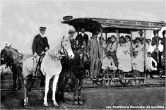 "Curitiba, Paraná (Brasil). The photograph below is said to show the inauguration in 1887. But that cannot be correct: (1) the tram is signed ""FONTANA"", which was not the first line to run [see map]; (2) the vehicle looks already worn out; (3) women did not wear their hair in pompadours until the 1890s. This picture was taken in the 1890s or early 1900s [Prefeitura Municipal de Curitiba. Roteiro da Cidade: Do bonde de mula ao ônibus expresso. Curitiba, 1973, p. 7; reproduced with permission]…"