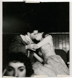 Couple kissing in movie theatre.  Photo by Brassai. Vintage photo. Vintage romance. Vintage kissing.  Vintage makeout session. Kissing like in the movies. Imagery that makes you pause.