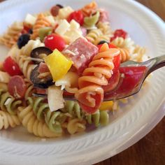 "Awesome Pasta Salad | ""I make this all the time & we LOVE it (especially my father-in-law)! I use tri color rotini, grape tomatoes, pepperonchinis instead of the green peppers, and some chunked red onion."""