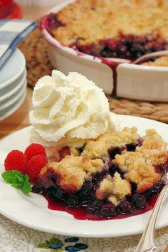 Warm blueberry cobbler goes perfect with a side of whipped cream. Get the recipe from Wicked Good Kitchen.   - Delish.com