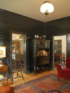 Love the black painted walls with the Hickory hardwood floors!  Great combination!