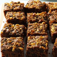Spicy Applesauce Cake Recipe -This picnic-perfecgt cake travels and slices very well. With chocolate chips, walnuts and raisins, it's a real crowd pleaser. —Marian Platt, Sequim, Washington
