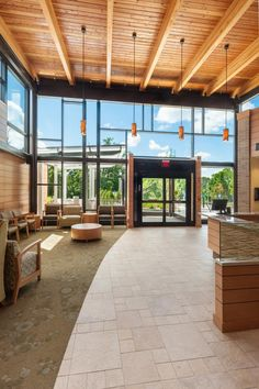 High ceilings, earthy materials, and natural lighting welcome patients, visitors, and staff to the reception area. Photo: © John Giammatteo.