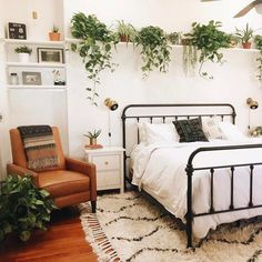 Interior, bedroom, bed, plants, shelves, chair, rug