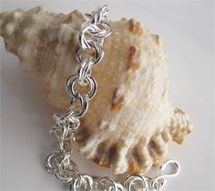 I handcrafted every bit of this double-links sterling chain bracelet. This could be a gift to be cherished forever and would become a family heirloom.   This bracelet is made up of 66 handmade, 5.5mm links of 16 gauge sterling silver wire. I made the entire bracelet by hand, including the clasp.This measures 7 1/2 inches long and weighs just under 20 grams.   * Find me on Facebook: http://www.facebook.com/DixSterling   * Follow me on Twitter @DixACee   * See whats happeni...