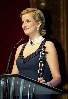 Princess Diana (1961 - 1997) presenting the Fashion Designer Awards at the Lincoln Center, New York, during a two-day visit to the city, January 1995. She is wearing a Catherine Walker gown and has her hair slicked back.