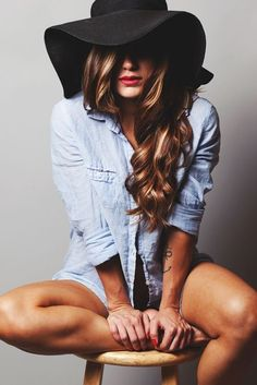 Way to rock a floppy black hat this summer, paired with bleached denim shirt