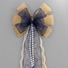 This navy blue sheer burlap wedding bow is accents with lace and pearls. This… #navyRusticWedding