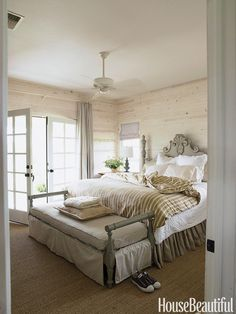 """The master bedroom has a wild sage color on the painted bench and again on the bed,"" Barber says. ""I love it against crisp white linen and whitewashed walls.""   - HouseBeautiful.com"