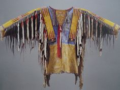 Dating from the 1860, made of native-tanned skin, paint, porcupine quill, human hair, ermine, feathers, silk ribbons.