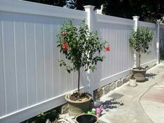 4 ft x 8 white composite fence panels on retaining wall - Google Search