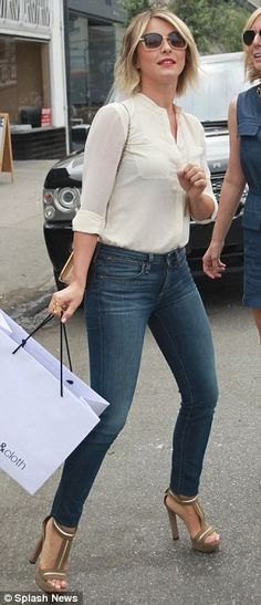 Casual: Dancer/actress Julianne Hough wore a pair of skinny jeans and cream blouse