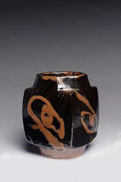 Shoji Hamada, slab-moulded bottle vase, tenmoku with poured slip design in iron