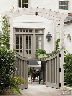 I great way to divide the side garden from the main garden making a dog friendly area pergola gate Color crush- Gray and white (The Enchanted Home) House Paint Exterior, Exterior House Colors, Exterior Siding, Siding Colors, Exterior Remodel, Beige House Exterior, White House Exteriors, Brick Exterior Makeover, White Exterior Paint