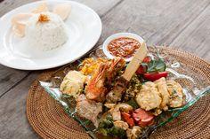 Nasi Campur ala Semar  Featuring simple example of Indonesian dishes consist of; sate Lilit, pepes ikan, ayam goreng kecap, tempe, prawn tempura, sayur plecing, sambal, served with steamed rice.