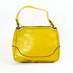 The Yellow #Leather_Handbag with a smiley face stich design will bring a smile to your face on any occasion. This Slim Design - #Yellow_Leather_Handbag delivers choice and personality. With internal pockets for storage and good leather for everyday accidents, this handbag is made to suit your needs!