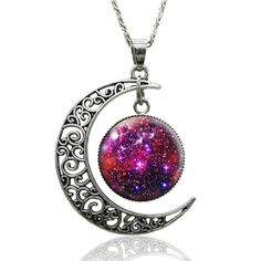 Galaxy inspired necklace featuring an open, cut out crescent moon charm with a space scene secured within a bezel which dangles from the moon charm. Wear alone or layer with other necklaces for effort