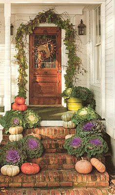 brick steps to wood porch  Love the flowering Kale in its fall purple!