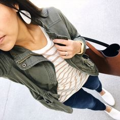 Putting Me Together: Instagram Roundup #21: White and beige striped t-shirt+skinny jeans+white slip-on shoes+brown tote bag+khaki utility jacket+earrings. Spring Casual Outfit 2017