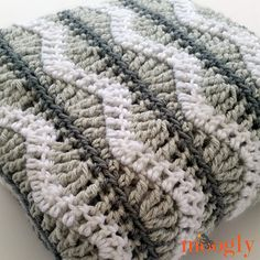 The Greyson Baby Blanket is a ripple afghan - with a twist! Every repeat you build up to the ripple row, and then even back out, creating a wave pattern within straight lines - an up to date take on a classic. Each row is unique, and the 4-row repeat is easier to memorize than you might think.